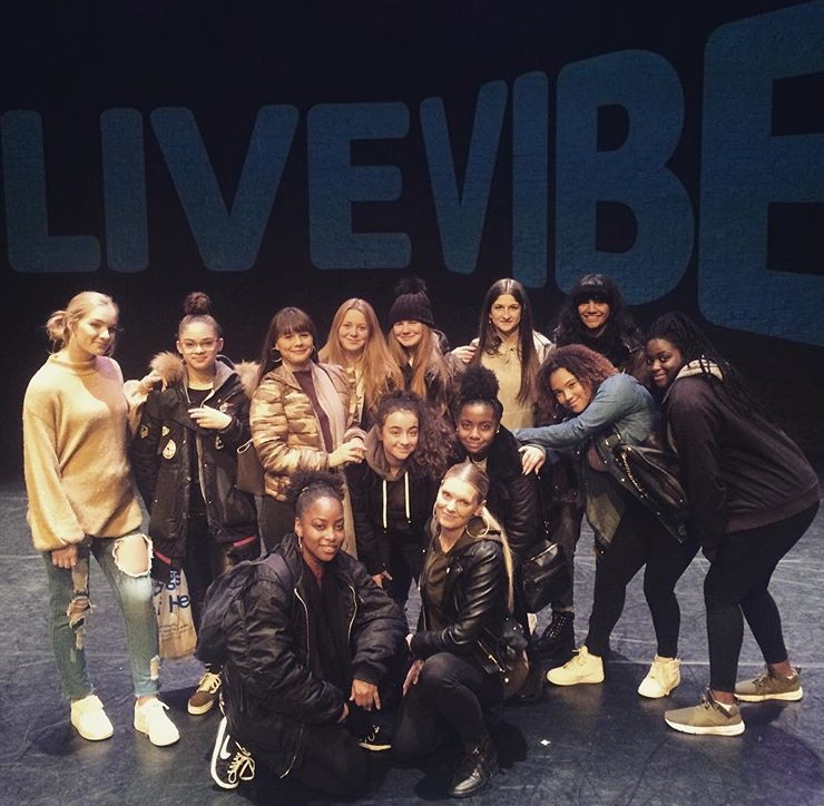Group shot on stage at Live Vibe