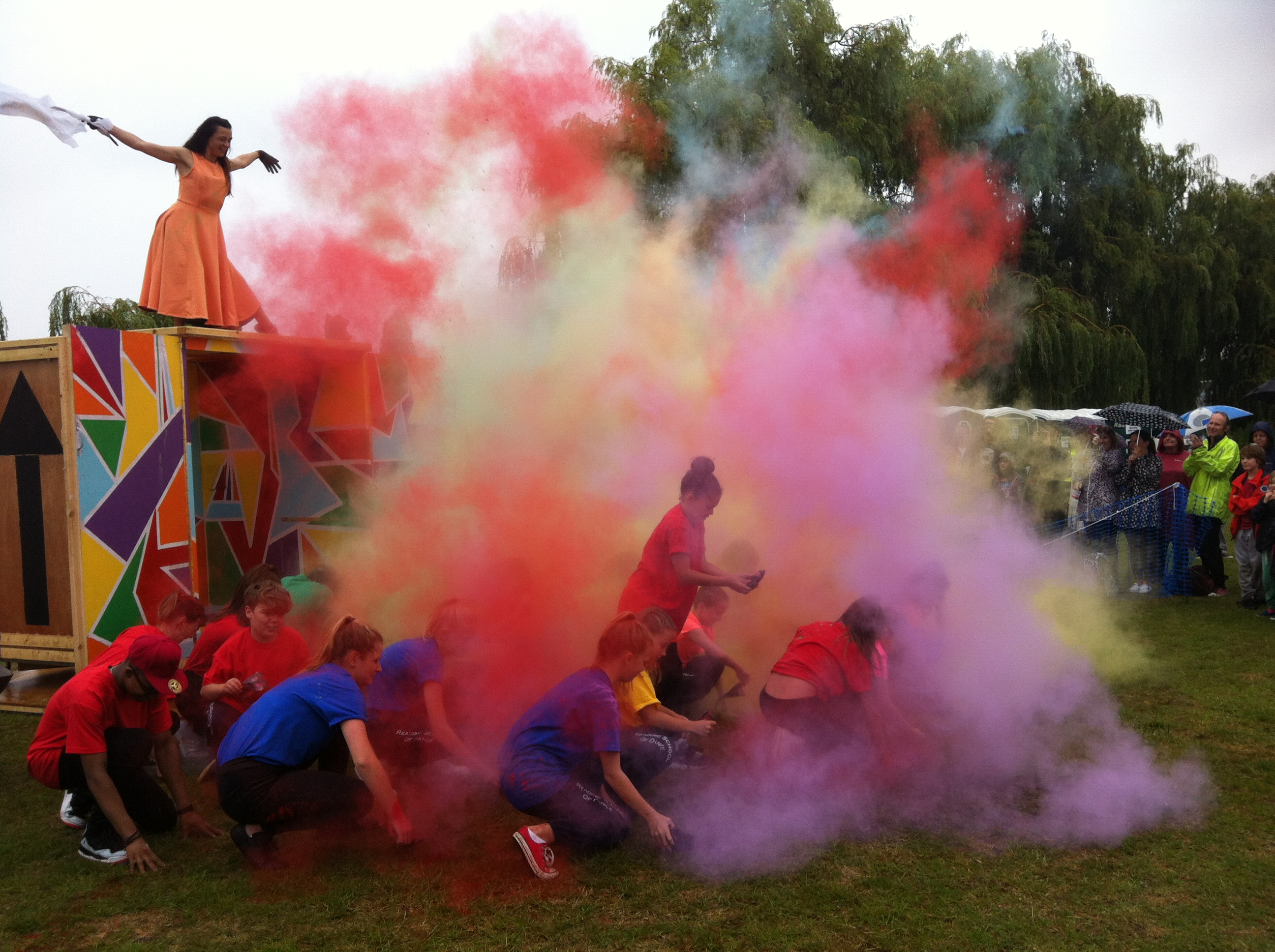 Outdoor performance with colourful smoke